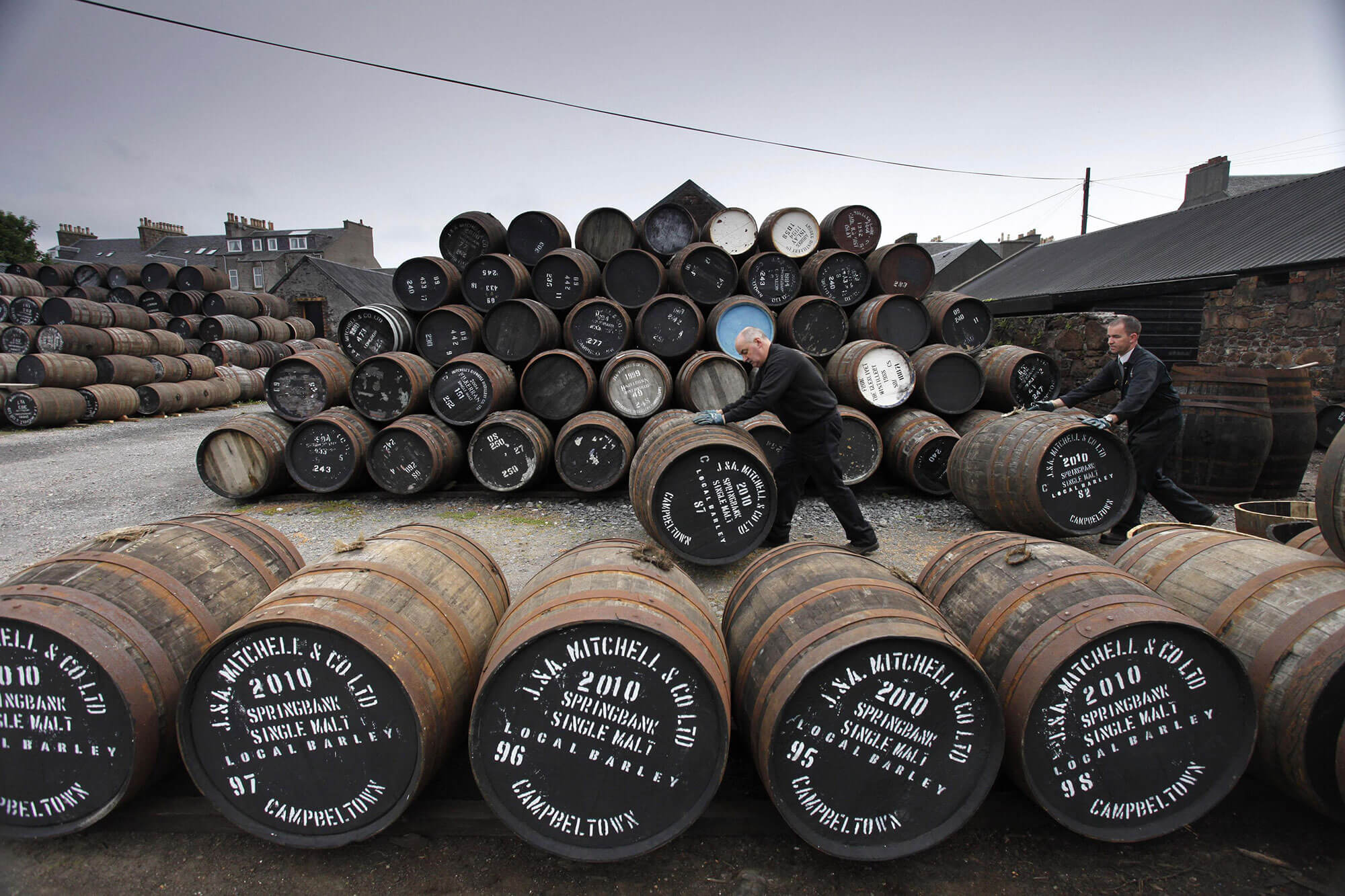 Barrels of whisky at a distilery