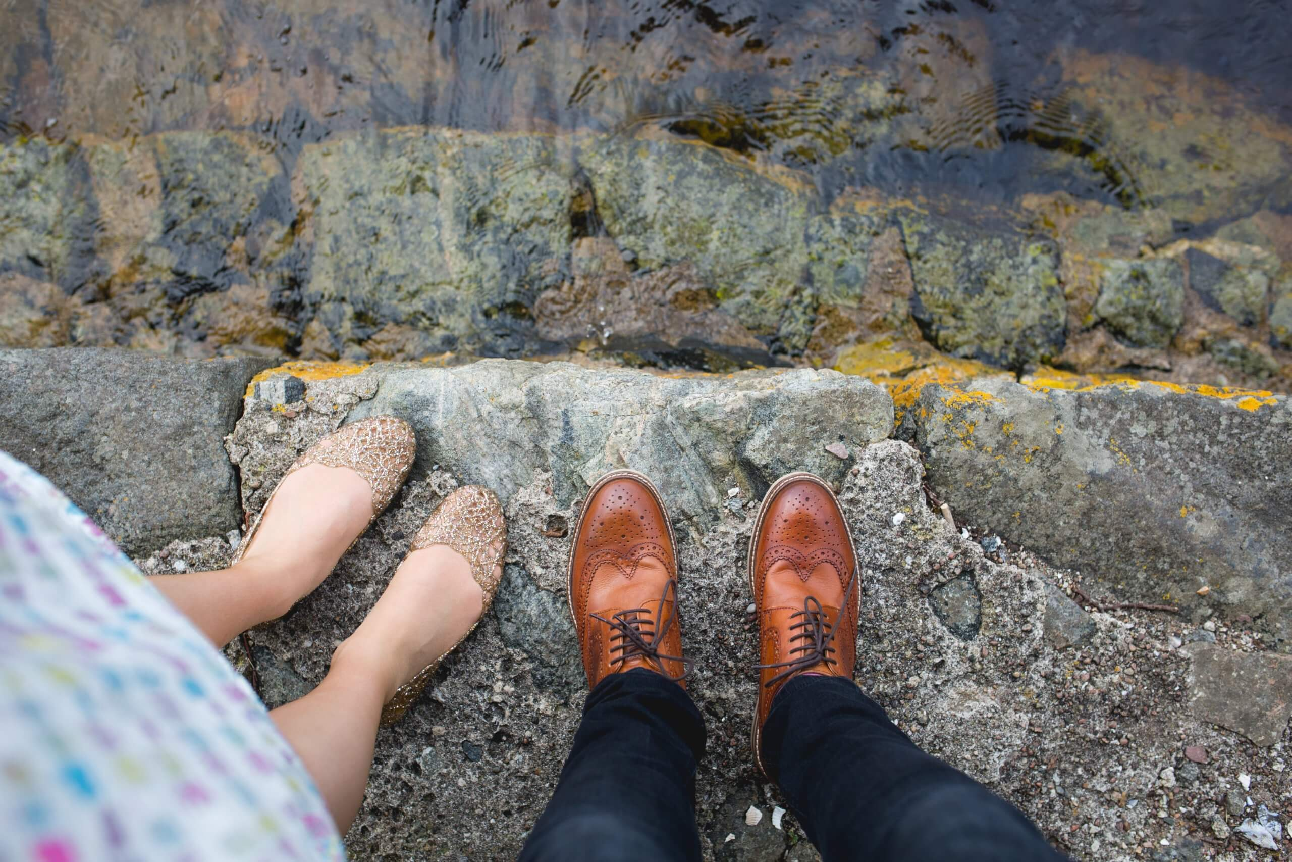 Image of 2 people standing by the waters edge
